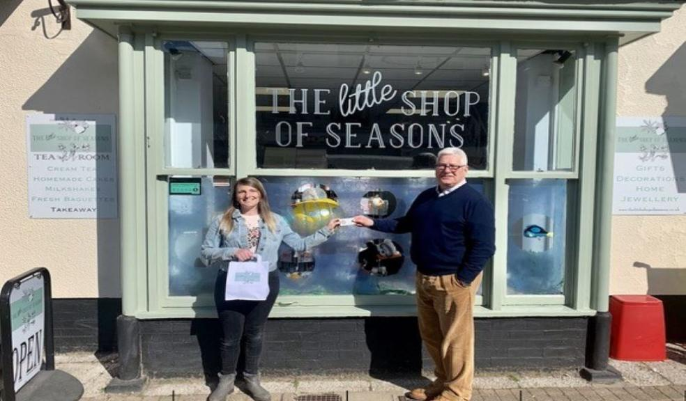 Competition winner, Hollie Broom with Roger Hemming from Roger Hemming Estate Agents, outside The Little Shop of Seasons in Honiton.